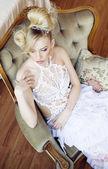 Beauty emotional blond bride in luxury interior — Стоковое фото