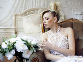 Beauty emotional blond bride in luxury interior — Stock Photo
