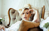 Beauty emotional blond bride in luxury interior — Стоковое фото