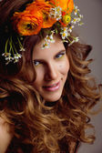 Beauty young woman with flowers in curly hair and make up — ストック写真