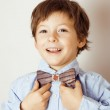 Little cute boy in bowtie smiling, making funny faces — Stock Photo #43678263