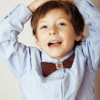 Little cute boy in bowtie smiling, making funny faces — Stock Photo #43678369