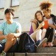 Cute group teenages at the building of university — Stock Photo