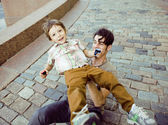 Little son with father in city hagging and smiling — Stock Photo