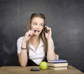 Portrait of happy cute student with book in classroom — Stock Photo