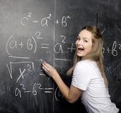 Porträtt av glad söt student med bok i klassrummet — Stockfoto