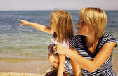 Mother with daughter at sea cost together — Stock Photo