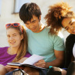 Cute group of teenages at the building of university with books huggings — Stock Photo #49611025
