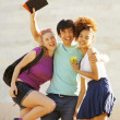 Cute group of teenages at the building of university with books huggings — Stock Photo #49611041
