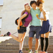 Cute group of teenages at the building of university with books huggings — Stock Photo #49611051