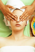 Stock photo attractive lady getting spa treatment in salon, close up asian hands on face — Stockfoto