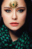 Beauty eastern woman with jewelry close up — Foto Stock
