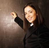 Portrait of happy cute student in classroom at blackboard — Foto Stock