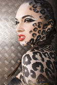 Young  sexy woman with leopard make up — Stock Photo