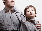 Father with son in bowties on white background, casual look — Stock Photo