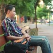 Teenager relaxing on bench — Stock Video