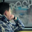 Boy riding bus and looking out window — Stock Video