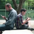 Father and son with tablet and smartphone — Stock Video