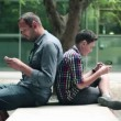 Father with son with smartphone — Stock Video