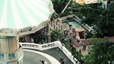 Spinning carousel in Tibidabo park — Stockvideo