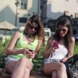Girlfriends with smartphone in the city — Stock Video