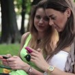 Girlfriends with smartphone — Stock Video #36964737