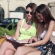 Girlfriends reading magazine — Stock Video