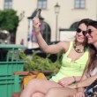 Girlfriends taking photo in the city — Stock Video #36965145