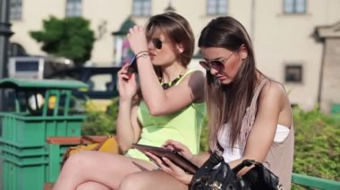 Girlfriends with cellphone and tablet — Stock Video