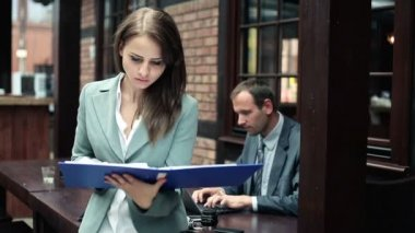Businesswoman reading documents — Stok video