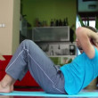 Stock Video: Mexercising, doing sit-ups