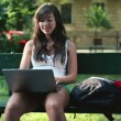 Student with laptop computer in city park — Stock Video #37034825