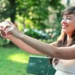 Young woman taking photo — Stock Video