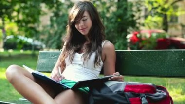 Student with tablet and notebook — Video Stock