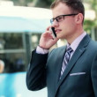 Stock Video: Young businessman talking on mobile phone