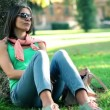Stock Video: Woman sitting in park