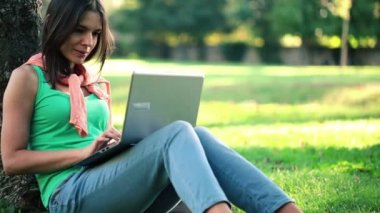 Pretty woman with laptop — Stock Video