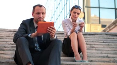 Businesspeople working with smartphone and tablet — Stock Video