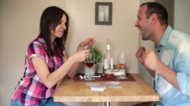 Couple playing poker game at home — Stock Video