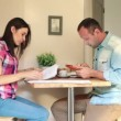 Couple with bills and tablet computer — Stock Video