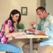 Overwhelmed couple counting bills — стоковое видео #38490129