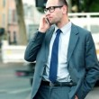 Stock Video: Businessman talking on cellphone