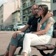 Couple in love sitting on bench — Stock Video #38499101