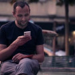 Man sending sms, texting on smartphone — Stock Video