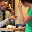 Businessman talking to his wife during breakfast — Stock Video #38551119