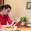 Woman with tablet computer drinking coffee — Stock Video #38552399