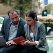 Stock Video: Business people using laptop and tablet