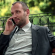 Businessman talking on cellphone — Stock Video