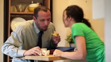Businessman eating breakfast — Stock Video
