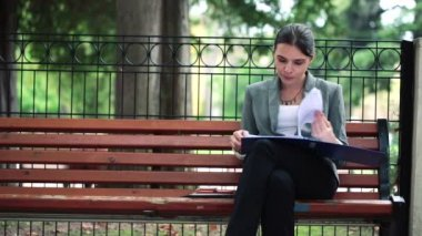 Businesswoman working with documents — Stock Video